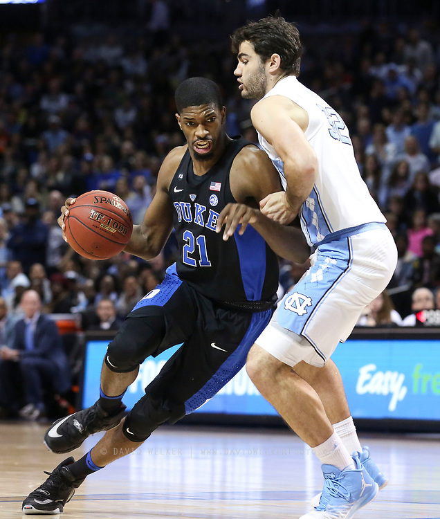 /du32/ drives past North Carolina forward Luke Maye (32) during the semifinals of the 2017 New York Life ACC Tournament at the Barclays Center in Brooklyn, N.Y., Friday, March 10, 2017. (Photo by David Welker, theACC.com)
