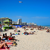 Crowds Sunning at South Beach in Miami Beach, Florida<br />