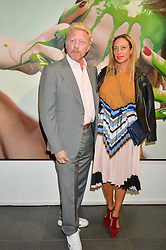 BORIS BECKER and his wife LILLY at a private view of woks by German artist Mike Dargas held at the Opera Gallery, 134 New Bond Street, London on 5th July 2016.