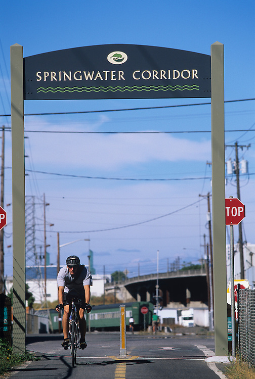 USA, Oregon, Portland,  Recreational bicyclists riding along Springwater Corridor on summer afternoon.