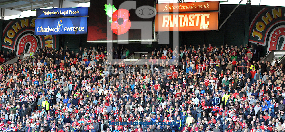Fans observe a min silence in rememberance during the Sky Bet Championship match at the John Smiths Stadium, Huddersfield<br /> Picture by Graham Crowther/Focus Images Ltd +44 7763 140036<br /> 01/11/2014