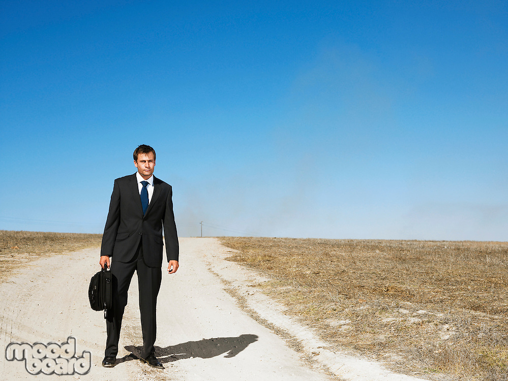 Man standing on remote road
