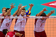 (l-R) Lukasz Zygadlo and Piotr Nowakowski and Michal Winiarski all from Poland blok against Emre Batur from Turkey during the 2013 CEV VELUX Volleyball European Championship match between Poland and Turkey at Ergo Arena in Gdansk on September 20, 2013.<br /> <br /> Poland, Gdansk, September 20, 2013<br /> <br /> Picture also available in RAW (NEF) or TIFF format on special request.<br /> <br /> For editorial use only. Any commercial or promotional use requires permission.<br /> <br /> Mandatory credit:<br /> Photo by &copy; Adam Nurkiewicz / Mediasport