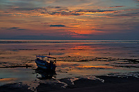 Boat stranded at dawn in Sanur Beach, in Bali, Indonesia