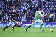 John McGinn is pursued by Harry Cochrane during the William Hill Scottish Cup 4th round match between Heart of Midlothian and Hibernian at Tynecastle Stadium, Gorgie, Scotland on 21 January 2018. Photo by Kevin Murray.