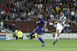 (L-R) Jordi Alba of FC Barcelona, Rodrigo Bentancur of Juventus FC during the UEFA Champions League group D match between FC Barcelona and Juventus FC  on September 12, 2017  at the Camp Nou stadium in Barcelona, Spain.