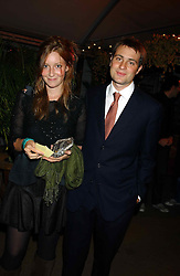 BEN & KATE GOLDSMITH at an exclusive evening featuring the greatest talents in fashion today in aid of the African children who have been affected bt the AIDS epidemic held at the Chelsea Gardener, Sydney Street, London on 20th September 2004<br />