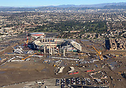 General overall aerial view of L.A. Stadium and Entertainment District at Hollywood Park under construction and the Forum on Friday, Dec. 7, 2018 in Inglewood, Calif. The venue, privately financed by Los Angeles Rams owner Stan Kroenke, is scheduled to open in 2020. It will be the home to the Rams and the Los Angeles Chargers and will play host to Super Bowl LVI in 2022, 2023 College Football National Championship and the opening and closing ceremonies of the 2028 Olympics,