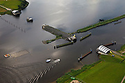 Nederland, Noordoostpolder, Flevoland, 30-06-2011. Ramspol, Waterkering Kampen, tussen Ketelmeer en Zwarte Water. Links Ramsdiep en Noordoostpolder. De balgstuw is een stormvloedkering en bestaat uit een opblaasbare dam of dijk, opgebouwd uit drie balgen. In niet-opgeblazen toestand liggen de balgen op de bodem..Naast de stuw grondwerk voor de nieuwe dubbelbaans Ramspolbrug..Ramspol, inflatable dike, between Ketelmeer and Black Water. The Balgstuw (bellow barrier) is a storm barrier and consists of an inflatable dam or dyke, composed of three bellows. Usually, each bellow rests on the bottom of the water...luchtfoto (toeslag), aerial photo (additional fee required).copyright foto/photo Siebe Swart