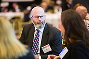 Garth Rosengren networks during the Bay Area Corporate Counsel Awards at The Westin San Francisco Airport in Millbrae, California, on March 18, 2019. (Stan Olszewski for Silicon Valley Business Journal)