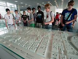Visitors look at historic model of Berlin  at Topographie des Terrors or Topography of Terror the former Gestapo Headquarters in Berlin