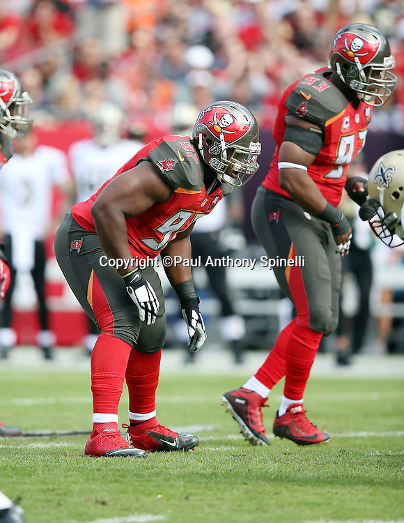 Tampa Bay Buccaneers defensive tackle Akeem Spence (97) gets set for the snap during the 2015 week 14 regular season NFL football game against the New Orleans Saints on Sunday, Dec. 13, 2015 in Tampa, Fla. The Saints won the game 24-17. (©Paul Anthony Spinelli)