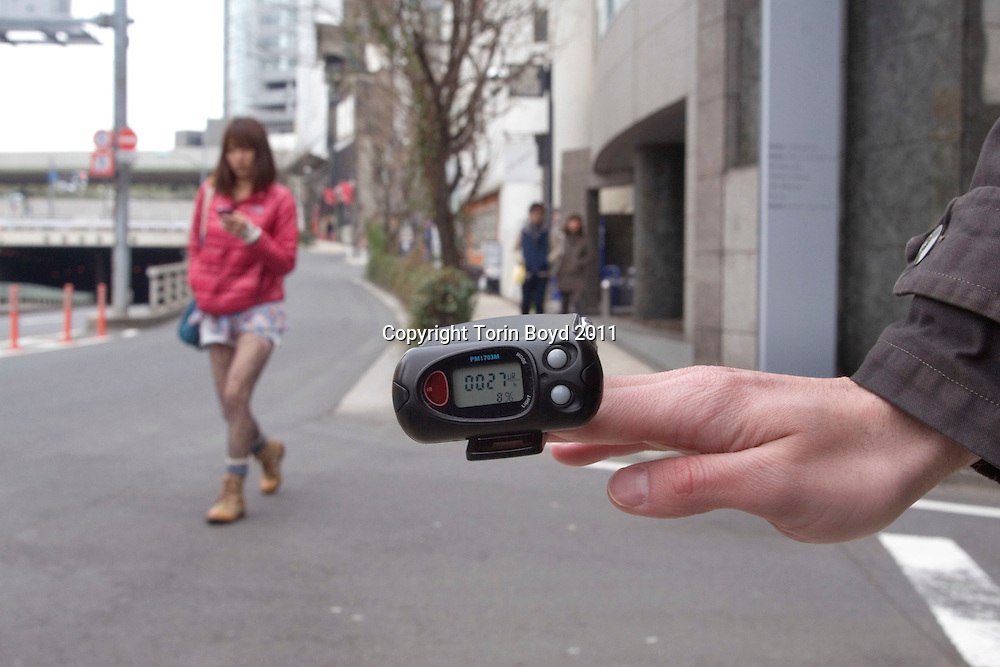 This 30 year old Steven Danieletto, the IT Manager for the English info magazine in Tokyo called Metropolis. He is seen here taking geiger counter readings in the Roppongi District of Tokyo. Danieletto, an Australian expat living in Tokyo, is a science major has been intrigued by all this radiation danger. So he began taking daily samples and posting them on youtube. His readings has been a relief to many expat living in Tokyo as many distrust official Japanese figures. But according to Danieletto, the air quality in Tokyo is safe at the moment, averaging about 0.02 micro sieverts, except for one day last week when there was a spike in which normal levels were 20 times higher. He also discovered that many plants have been getting double the amount of readings, especially due to the past three days of rain. Japanese officials have announced that there are low levels of radiation in spinach, milk, and now drinking waters which has been causing many Japanese to hoard food and bottled water. When this photo was taken on March 24, 2011, it was nearly impossible to find bottled water anywhere in the Tokyo area.