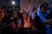Yazidis gather outside the Holy Temple in Lalish to celebrate the first Yazidi New Year since victory over ISIS in Iraq was declared.