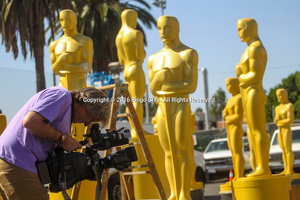 A cameraman films the Oscar statues are seen at a Hollywood back lot near the Dolby Theatre Feb. 25, 2016 in Los Angeles. The 88th Academy Awards will be held Sunday, February 28, 2016. (Photo by Ringo Chiu/PHOTOFORMULA.com)<br /> <br /> Usage Notes: This content is intended for editorial use only. For other uses, additional clearances may be required.