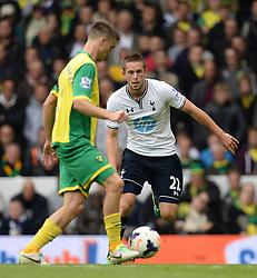 Norwich's Ricky van Wolfswinkel and Tottenham's Gylfi Sigurosson compete for the ball  - Photo mandatory by-line: Mitchell Gunn/JMP - Tel: Mobile: 07966 386802 14/09/2013 - SPORT - FOOTBALL -  White Hart Lane - London - Tottenham Hotspur v Norwich - Barclays Premier League
