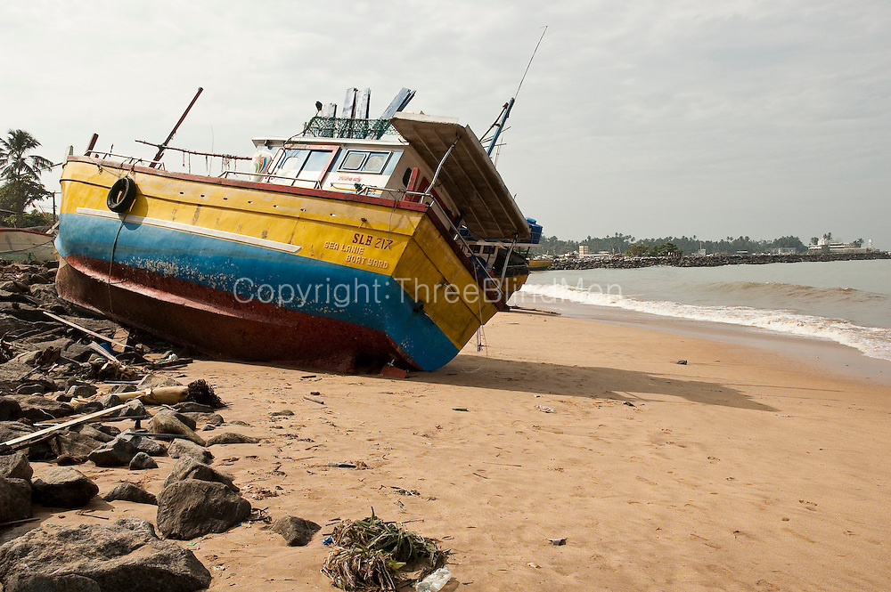 Wrecked boats on south west coast from fishing harbour at Beruwela.