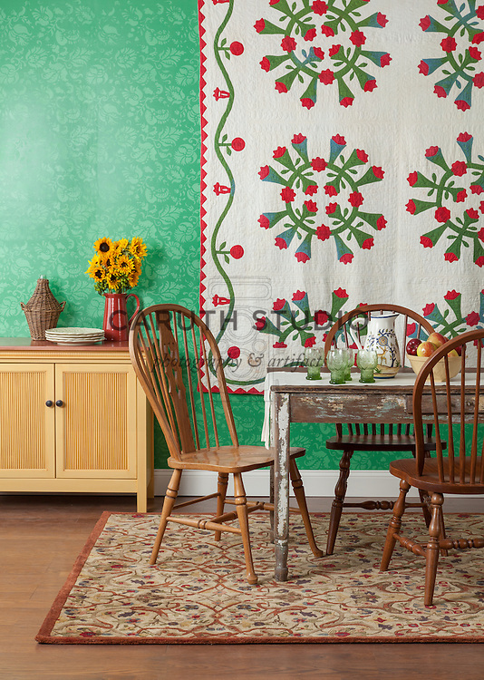 Country style dining room with antique quilt