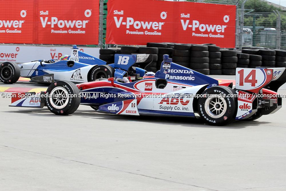 June 27, 2014: Takuma Sato #14 and Carlos Huertas #18 in turn 2 during practice for the IndyCar Series Grand Prix of Houston at MD Anderson Cancer Center Speedway in Houston, TX.