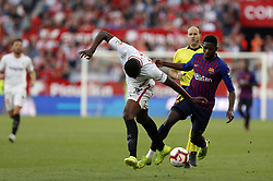 February 23, 2019 - Seville, Madrid, Spain - Ibrahim Amadou (Sevilla FC) and Ousmane Dembele (FC Barcelona) are seen in action during the La Liga match between Sevilla FC and Futbol Club Barcelona at Estadio Sanchez Pizjuan in Seville, Spain. (Credit Image: © Manu Reino/SOPA Images via ZUMA Wire)