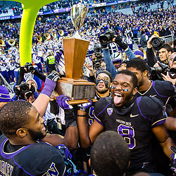 SEATTLE, WASHINGTON - NOVEMBER 29: The Washington Huskies celebrate winning the 106th Apple Cup versus Washington State at Husky Stadium in Seattle, WA. (Photo by Christopher Mast/247Sports)