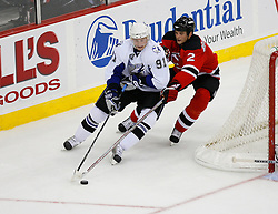 Nov 5, 2008; Newark, NJ, USA; Tampa Bay Lightning center Steven Stamkos (91) skates with the puck by New Jersey Devils defenseman Sheldon Brookbank (2) during the second period at the Prudential Center.