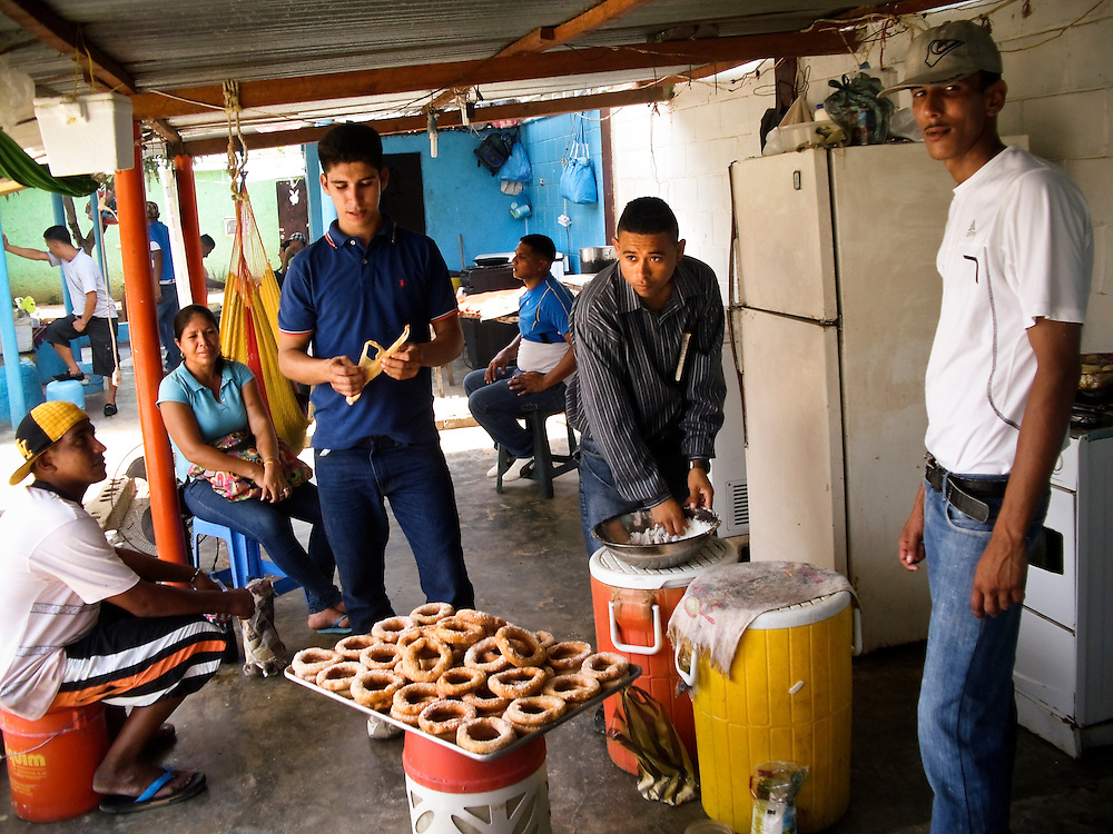 Prisoners make donuts to sell inside San Antonio prison in Porlamar, Venezuela. A lot of prisoners have some sort of business or work that allows them to earn money on the inside.