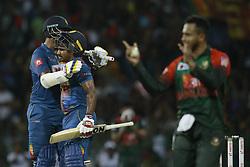 March 16, 2018 - Colombo, Sri Lanka - Sri Lankan cricketer Kusal Perera celebrates with Thisara Perera after scoring 50 runs during the 6th T20 cricket match of NIDAHAS Trophy between Sri Lanka  and Bangladesh at R Premadasa cricket ground, Colombo, Sri Lanka on Friday 16 March 2018. (Credit Image: © Tharaka Basnayaka/NurPhoto via ZUMA Press)