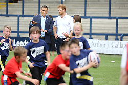 © Licensed to London News Pictures. 06/07/2017. Leeds UK. HRH Prince Harry is meeting children, coaches & players at the Headingley Carnegie Stadium in Leeds today as part of the Sky Try Rugby League Festival. Photo credit: Andrew McCaren/LNP