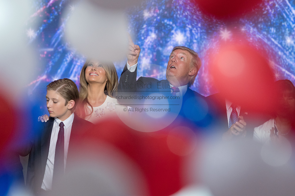 GOP Presidential candidate Donald Trump and family members watch as balloons and confetti drop after accepting the party nomination for president on the final day of the Republican National Convention July 21, 2016 in Cleveland, Ohio.