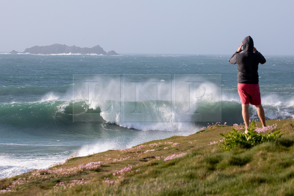 © Licensed to London News Pictures. 22/05/2020. Padstow, UK. Huge waves of up to 15ft hit the coastline at Harlyn bay and the surrounding coves of North Cornwall. There is currently no RNLI Lifeguard service in the county due to Coronavirus (Covid-19), potentially causing issues as an unusual combination of large swell and warm weather is expected during the upcoming bank holiday weekend. Photo credit : Tom Nicholson/LNP