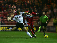 Photo: Andrew Unwin.<br /> Middlesbrough v Fulham. The Barclays Premiership.<br /> 20/11/2005.<br /> Fulham's Moritz Volz (L) looks to tackle Middlesbrough's Yakubu (R).