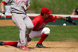 15 April 2006:  Redbird's first baseman Jay Molina can't wrangle this throw and Bradly's runner is safe. Bradley University Braves are defeated in game one of a double header against the Illinois State University Redbird at Redbird Field in Normal IL.