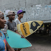 young surfer inside the Rocinha's slum narrow streets