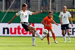 07-06-2011 VOETBAL: DUITSLAND - NEDERLAND: AACHEN<br /> Zweikampf zwischen Merstin Garefrekes (Deutschland, Frankfurt) (L) und Renee Slegers (Niederlande, Dujrgarden)  // during the WM 2012 Friendly Game Germany vs Netherland at Tivoli Aachen <br /> *** NETHERLANDS ONLY ***<br /> ©2011-FotoHoogendoorn.nl/ nph / Mueller