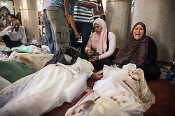 60360910  <br /> An Egyptian woman cries beside a dead body at a mosque where lines of bodies wrapped in shrouds were laid out in Cairo, Egypt, August 15, 2013. At least 525 were killed and 3,717 others injured across Egypt in clashes between supporters of ousted President Mohamed Morsi and the security troops, after the latter dispersed Wednesday two major pro-Morsi sit-ins in Cairo and Giza, a Health Ministry official said Thursday, August 15, 2013. <br /> Picture by imago / i-Images<br /> UK ONLY