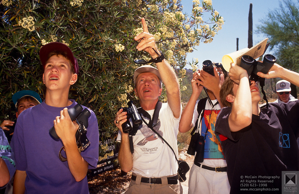 Camper Justin Jones, left, looks for a bird as Victor Emanuel points, Tucson, Arizona..Media Usage:.Subject photograph(s) are copyrighted Edward McCain. All rights are reserved except those specifically granted by McCain Photography in writing...McCain Photography.211 S 4th Avenue.Tucson, AZ 85701-2103.(520) 623-1998.mobile: (520) 990-0999.fax: (520) 623-1190.http://www.mccainphoto.com.edward@mccainphoto.com.