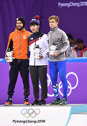 PYEONGCHANG, Feb. 10, 2018  Gold medalist South Korea's Lim Hyojun (C), silver medalist Sjinkie Knegt of the Netherlands, bronze medalist Olmypic athlete Semen Elistratov of Russia react during the venue ceremony after the men's 1500m final of short track speed skating event on the 2018 Pyeongchang Winter Olympic Games at Gangneung Ice Arena, South Korea, Feb. 10, 2018. Lim Hyojun won the gold medal in a time of 2:10.485 and set a new Olympic record of the event. (Credit Image: © Ju Huanzong/Xinhua via ZUMA Wire)