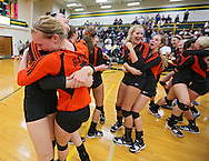 West Delaware's Bridget Hoffmann (6) and Emily Thole (7) hug as their team celebrates following their Class 4A regional final match at Beckman High School in Dyersville on Tuesday, November 5, 2013. West Delaware defeated Xavier 3-1.
