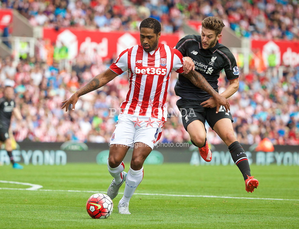 STOKE-ON-TRENT, ENGLAND - Sunday, August 9, 2015: Liverpool's Adam Lallana in action against Stoke City's Glen Johnson during the Premier League match at the Britannia Stadium. (Pic by David Rawcliffe/Propaganda)