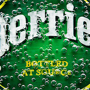 Perrier Bubbles permeating bottle label Ray Massey is an established, award winning, UK professional  photographer, shooting creative advertising and editorial images from his stunning studio in a converted church in Camden Town, London NW1. Ray Massey specialises in drinks and liquids, still life and hands, product, gymnastics, special effects (sfx) and location photography. He is particularly known for dynamic high speed action shots of pours, bubbles, splashes and explosions in beers, champagnes, sodas, cocktails and beverages of all descriptions, as well as perfumes, paint, ink, water – even ice! Ray Massey works throughout the world with advertising agencies, designers, design groups, PR companies and directly with clients. He regularly manages the entire creative process, including post-production composition, manipulation and retouching, working with his team of retouchers to produce final images ready for publication.