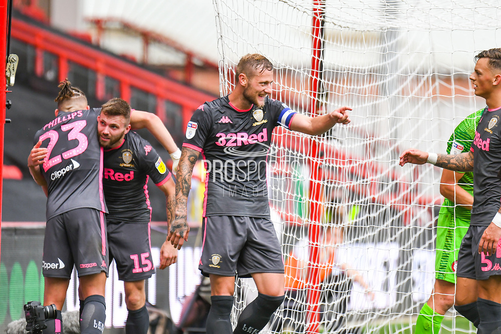 Liam Cooper of Leeds United (6) celebrates Jack Harrison of Leeds United (22) goal during the EFL Sky Bet Championship match between Bristol City and Leeds United at Ashton Gate, Bristol, England on 4 August 2019.