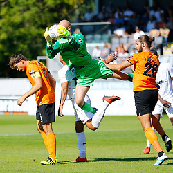 Barnets keeper Mark Cousins makes an acrobatic save to deny Dovers forward Jamie Allen during the National League match between Dover Athletic and Barnet FC at Crabble Stadium, Kent on 1 September 2018. Photo by Matt Bristow.