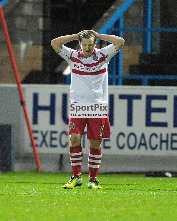 Gary Warren (ICT, Blue &amp; Red) gets a header in to prevent Steven Doris (Stirling Albion, red &amp; white, 9) from snatching a late winner for the home side<br /> <br /> Stirling Albion v Inverness Caledonian Thistle, Scottish Cup, Saturday 9th January 2016<br /> <br /> (c) Alex Todd | SportPix.org.uk