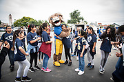 Los Angeles Rams mascot Rampage poses with students during community improvement project at Belvedere Elementary School to upgrade play and social spaces around the school by building a new playground structure, painting murals and basketball backboards and landscaping., Friday, June 14, 2019, in Los Angeles, Calif. (Ed Ruvalcaba/Image of Sport)