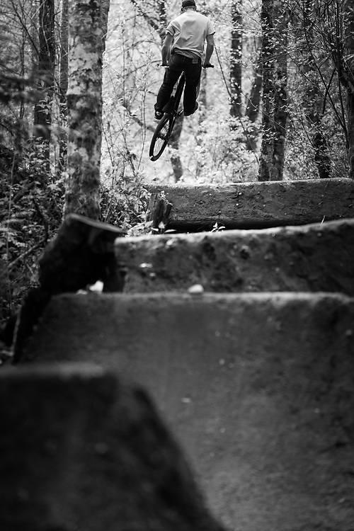 Owen Dudley gets air on a private jump trail near Bellingham Washington.