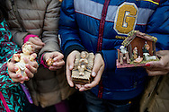 Vatican City dec 20th 2015, the pope blesses Baby Jesus figurines in St Peter's Square, during the Angelus prayer. In the picture children with figurines