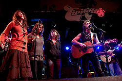 17 December,05. Tipitina's, New Orleans, Louisiana.<br />  Arlo Guthrie and friends Riding on the city of New Orleans tour benefiting Musicares Hurricane relief 2005 sponsored by Amtrak. Sarah Lee Guthrie  (l) and her sisters wow the crowd on the last date of the hugely successful tour raising money for hard hit New Orleans musicians.<br /> Photo; ©Charlie Varley/varleypix.com