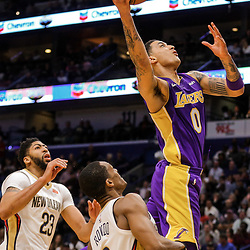 Mar 22, 2018; New Orleans, LA, USA; Los Angeles Lakers forward Kyle Kuzma (0) shoots over New Orleans Pelicans guard Rajon Rondo (9) and forward Anthony Davis (23) during the second quarter at the Smoothie King Center. Mandatory Credit: Derick E. Hingle-USA TODAY Sports