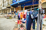 "03 DECEMBER 2012 - BANGKOK, THAILAND:  A worker's clothes hang out to dry in ""Washington Square"" in Bangkok. Workers live on the premises while they demolish it, moving on when they are done. Washington Square was a notorious adult ""entertainment"" and red light district on Sukhumvit Soi 22 in Bangkok. Many of the bars and massage parlors catered in the district to older American and European men and opened in the 1960's when Bangkok was a ""R&R"" destination for American servicemen in Vietnam. It's being torn down to make way for new high rise hotels and condominiums.         PHOTO BY JACK KURTZ"